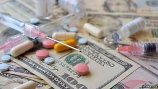 Medicine and dollar bills