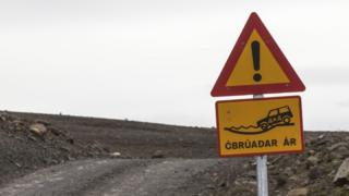 An Icelandic road sign marking a ford crossing a river