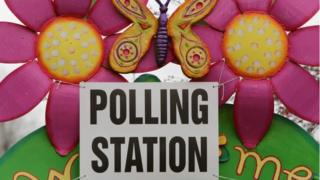 A sign indicates a polling station set up at a school in Castlederg, County Tyrone