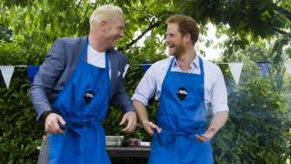 Iwan Thomas and Prince Harry at Heads Together event at Kensington Palace - cooking burgers