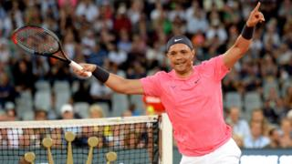 Trevor Noah celebrates winning a point in a tennis match in Cape Town, South Africa - Friday 7 February 2020