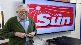 David Hockney with his Sun logo