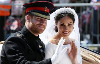The Duke and Duchess of Sussex wave from the Ascot Landau Carriage during their carriage procession