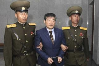 Kim Dong-chul, centre, a US citizen detained in North Korea, is escorted to his trial Friday, 29 April 2016, in Pyongyang, North Korea