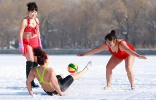 Women play ball games on a snow-covered field in Shenyang, China