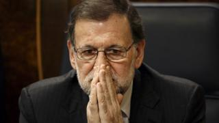 "Spain""s Prime Minister Mariano Rajoy sits in parliament"