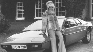 Female model sat on the bonnet of a Lotus Esprit