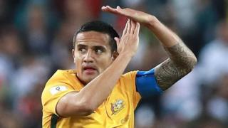 Tim Cahill making a T sign with his hands after he kicked a goal in a World Cup qualifying match.
