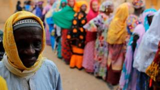People wait to cast their vote at a polling station in Fatick, Senegal, on 24 February 2019