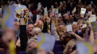SNP delegates waiving their accreditation at the 2017 conference