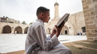 Boy reciting the Quran
