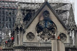Inspectors are seen on the roof of Notre-Dame Cathedral