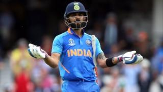 Virat Kohli gestures during the ICC Cricket World Cup group stage match at The Oval, London