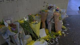 Flowers were placed in tribute to the homeless man
