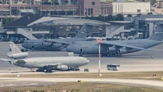 coronavirus stock Military planes of the United States Air Force stand on the tarmac of Ramstein air base