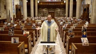 in_pictures Rev Brian X Needles live-streams Easter Sunday Mass to picture print-outs sent in by parishioners and attached to pews by staff at Our Lady of Sorrows Catholic Church in South Orange, New Jersey, 12 April 2020