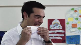 Greek Prime Minister Alexis Tsipras prepares to cast his ballot during the Greek referendum in Athens 5 July 2015