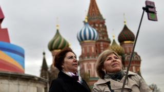 Tourists using a selfie stick in Moscow