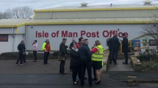 Postal staff outside the sorting office