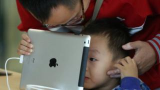 A child looking at an iPad