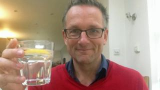 Michael Mosley with glass of water