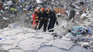 Rescue workers at the scene of a building collapse in Tenerife