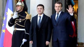 French President Emmanuel Macron (R) welcomes Ukrainian president Volodymyr Zelensky at the Elysee Palace, Paris, 9 December 2019