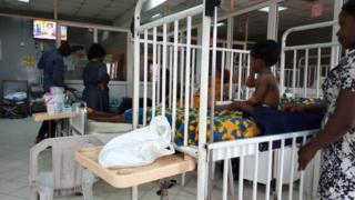 Patients wey dey for hospital bed dey wait for doctors to come attend to dem.