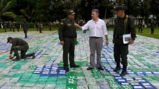 President Juan Manuel Santos (2R) in the middle of packages containing cocaine, in Apartado, in the Department of Antioquia, Colombia, 08 November 2017.