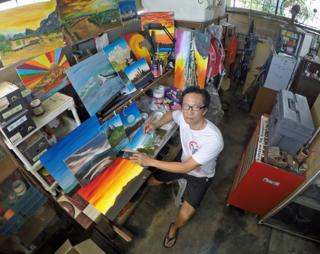 Man with his paintings in Malaysia