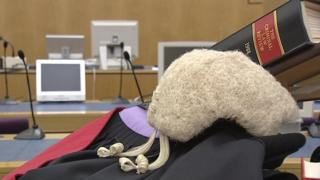 Barrister's wig and legal reference books in court