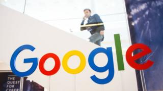 Man looks at google logo