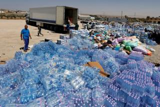 Humanitarian aid for Syria is prepared in the town of Ramtha, Jordan, 2 July 2018