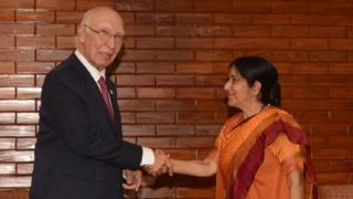 "Indian Foreign Minister Sushma Swaraj(R)and Pakistan""s Foreign Affairs Advisor Sartaj Aziz shake hands during a meeting on the sidelines of The South Asian Association for Regional Cooperation(SAARC)foreign minister""s meeting in Pokhara, some 200kms west of Kathmandu on March 17, 2016"