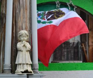 Mexican flag in front of house