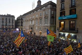 People gather to celebrate the proclamation of a Catalan republic on Sant Jaume Square in Barcelona, 27 October