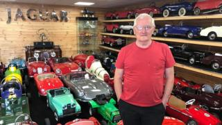 David Morrow with his collection of vintage pedal cars