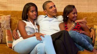 Barack Obama, Malia Obama and Sasha Obama on sofa