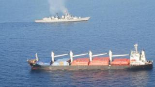 The INS Mumbai and a hijacked ship in the Gulf of Aden - 9 April 2017