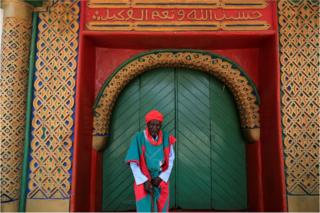 "A palace guard stands in front of the Emir""s palace before the start of the Durbar festival, on the second day of Eid al-Adha celebration, in Nigeria""s northern city of Kano September 2, 2017."