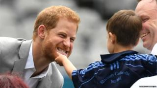Prince Harry has his beard stroked