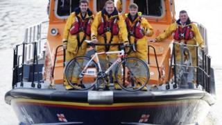 RNLI lifeboat crew and a bike