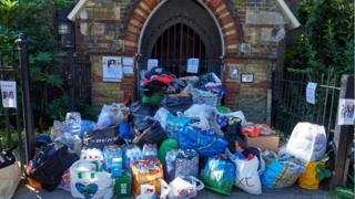 a huge pile of full plastic bags