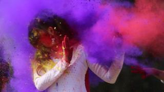 Colour being thrown on a woman