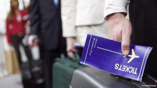 Passenger holding a boarding pass