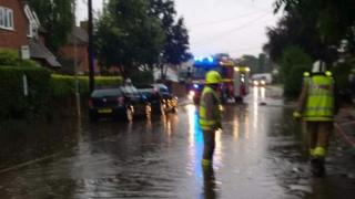 Firefighters pumping water away in Cholsey