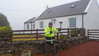 Taking a measurement at the highest house in Scotland