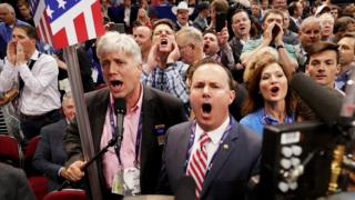 Sen. Mike Lee, (R-UT) and Phil Wright, Vice Chair of the Utah State Delegation (L) shout no to the adoption of rules withou a roll call vote on the first day of the Republican National Convention on July 18, 2016