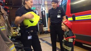 Firefighters Danielle Whitham and Emma Hawthorn with Grace