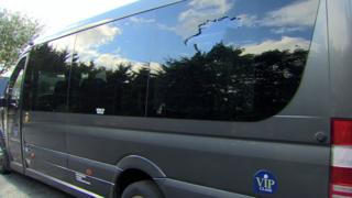 A damaged window on the bus